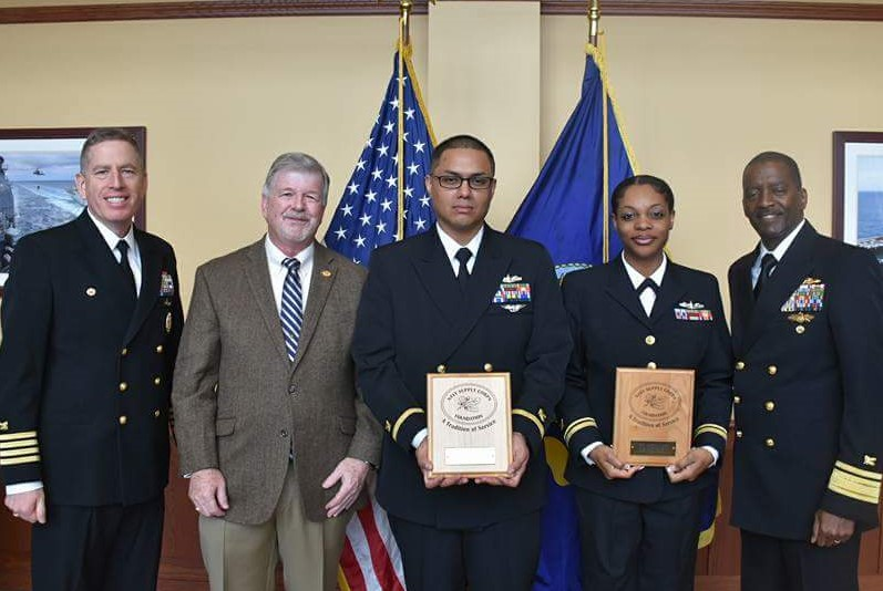 From left to right: CAPT Doug Noble, Jack Evans, ENS Bernardo Tinoco, ENS Comatrice Martin, RADM Keith Jones
